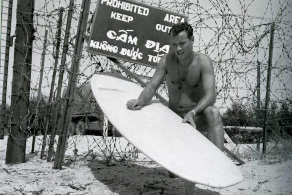 Cpl Bob Rossier, Australian army, waxes down his board, CDS p 74